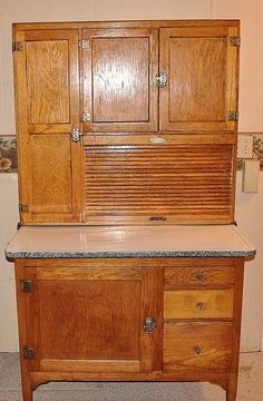 Hoosier Cabinet...this looks like mine. My Grandparents had painted it PINK...now it is back to the start of warm oak