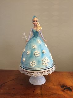 Frozen Elsa doll Dolly Varden cake with fondant snowflakes. Frozen themed barbie birthday cake with singing Elsa doll