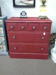 SOLD - This petite chest has 3 dove tail constructed drawers. It has been painted red and distressed with black and white drawer pulls.  It measures approximately 30 inches across the front 18 inches deep and stands 30 inches tall.  It can be seen in booth E6 at Main Street Antique Mall 7260 East Main Street ( E of Power Rd ) Mesa, AZ 84207 480 9241122open 7 days a week 10a.m to 5 : 30p.m Cash or charge accepted