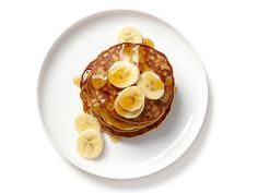 """Go Bananas: Food Network Stars' Easy Banana Recipes : """"I make 3-ingredient pancakes all the time: Mash 1 banana; mix with 1 tablespoon peanut butter and 1 beaten egg. Spray a hot nonstick pan with cooking spray; add tablespoonfuls of the mixture and cook 1 to 2 minutes per side. Top with banana slices."""" — Kelsey Nixon"""