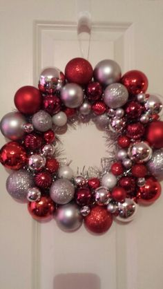 Red and silver bauble wreath .