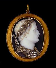 Napoleon I cameo pendant. Double-sided pendant, the front set with an onyx cameo portrait of Napoleon I facing in profile towards the right, crowned with diamond laurel leaves tied with ribbons, the drapery at the neck similarly set with diamonds, fastened with a brooch bearing the cipher N and pinned with golden bees. The lapis lazuli plaque at the back bears a chased golden eagle gripping a thunderbolt in its claws. Mounted in a plain gold frame with suspension loop. Signed MORELLI.
