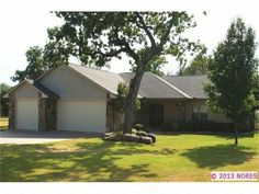 33257 S 529 Road, Cookson, OK. THIS GORGEOUS, MOVE IN READY, 3 BEDROOM, 2 BATH, 3 GARAGE STONE/VINYL HOME WAS CUSTOM BUILT WITH ALL THE EXTRAS! STAINLESS APPLIANCES, HARDWOOD FLOORS, GRANITE COUNTERTOPS, JACUZZI TUB, SECURITY SYSTEM, FENCED YARD W/ SPRINKLER, COVERED PATIO & MORE!!