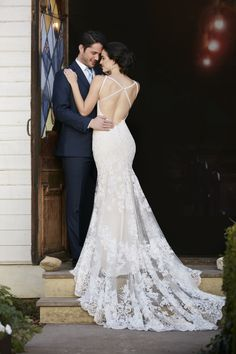 Wedding gown with a low back with illusion train by Martina Liana.