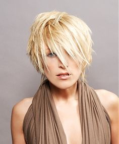 A short blonde straight coloured spikey choppy Layered hairstyle by seanhanna