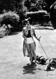 Isabella Blow. Just.... taking the dogs for a walk. In this outfit, with this hat on. YES!
