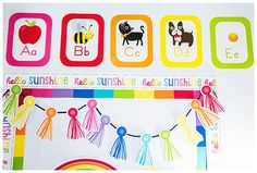 Hello Sunshine - SchoolgirlStyle www.schoolgirlstyle.com  rainbow classroom decor, unicorn classroom theme, classroom organization, teacher desk, bulletin boards, rainbow decor, birthday set Kindergarten Classroom Decor, Classroom Crafts, Classroom Themes, Toddler Classroom, Preschool Decor, Preschool Class, Teacher Supply Store, Teacher Supplies, Alphabet Line