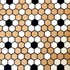 Hexagonal tiles are pretty affordable.  Picture this in pale blue and white.