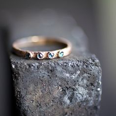 This ring is a hand formed band in custom alloyed 14 karat Rose Gold 2mm hammered band. With 4 2mm rose blue diamonds.    This ring was created
