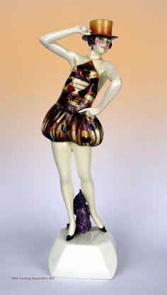 """An Art Deco ceramic figurine designed by Stefan Dakon for Goldscheider, Vienna c1927/28 - """"Zylinger"""" (Top Hat)."""