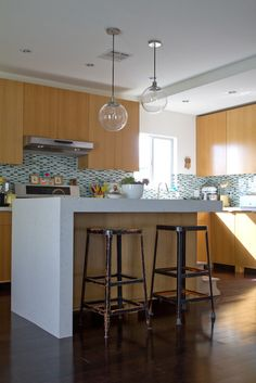 West Elm Globe Pendant Light in a kitchen via @Apartment Therapy