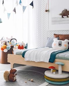 Scandi inspired kids bedroom by Oh.Eight.Oh.Nine. Bed from Urban Baby; rug and garland from Talo Interiors.