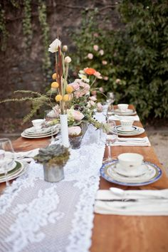 Love the lace and the vintage, tablescape.  under the trees, i like the mismatched idea.