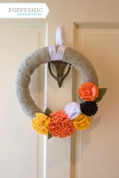 like the burlap...you could always velcro on the flowers and change out the colors seasonally