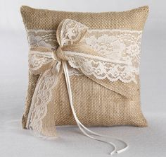 This beautiful Country Romance Ring Bearer Pillow will combine rustic and elegance to your wedding ceremony.  Burlap ring pillow is decorated in delicate lace in your choice of white or ivory and features layered jute ribbon and lace bows.