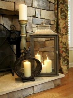 this grouping of lanterns & candles; flameless candles maybe?Love this grouping of lanterns & candles; flameless candles maybe? Candles In Fireplace, Living Room With Fireplace, Fireplace Ideas, Mantel Ideas, Fireplace Hearth Decor, Fireplace Mantel Decorations, Fire Place Mantel Decor, Mantles Decor, Basement Fireplace