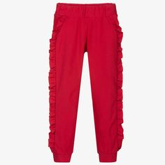 Red joggers for girls, by Everything Must Change. Made from soft cotton jersey, they have a lovely ruffle detail down the side of each leg, and an elasticated waistband for comfort. Red Joggers, Girls Joggers, Everything Must Change, Kids Online, Trousers, Sweatpants, Legs, Detail, Cotton