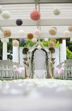 Love the touch the floral balls give this look. Try our hanging feather balls in Ivory to re-create this look!