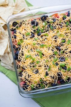 The best healthy seven layer dip recipe! Great for parties and Super Bowl Sunday.