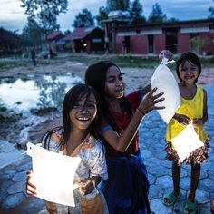 Grins that outshine the brightest light. Renewable energy nonprofit @twendesolar helps us spread light in Cambodia to young schoolgirls. ⠀ ⠀ #LightYourWorld #nonprofit #startup #energy #smiles