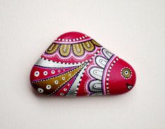 Beach stone with hand-painted designs in acrylics  These stones are unique with their design. I paint and draw all of my original designs by hand with the acrylic paints, small brushes or paint pens with extra fine tip. I use also isographs (0,2 / 0,3) with different inks. No stencils are used. All designs are created with my imagination. They are protected with 2 or 3 layers of high quality acrylic varnish coat and are signed & numbered . The pebbles are water resistant, to clean, just…