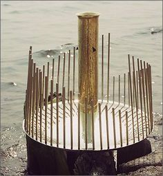 """""""Waterphones are stainless steel and bronze monolithic, one-of-a-kind, acoustic, tonal-friction instruments that utilize water in the interior of their resonators to bend tones and create water echos. The rods can be played with superball mallets, by hand or with a bow."""""""