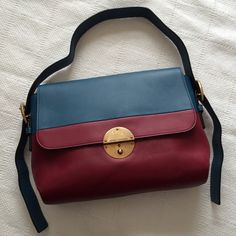 "Marc Jacobs Cobalt + Oxblood Colorblock Bag Approx. 12""W x 9""H x 3 1/2""D with a 7-12"" adjustable and removable strap drop. Antiqued gold hardware, push-lock closure with optional lock, one interior zip pocket, two interior slip pockets. Gently used. The interior is clean. Light corner wear and a few small scuffs, but nothing major.   ✅ OFFERS  ❌ TRADES ✨ SHIPS FAST Marc Jacobs Bags Shoulder Bags"