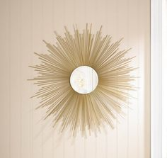 A stunning addition to any room, this gorgeous sunburst mirror takes a touch of vintage style and makes a modern masterpiece. It features a beveled mirror inset in a burst of shimmering golden sunshin