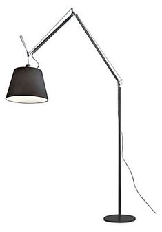 Tolomeo's slender aluminum frame and exposed tension cables give it a modern, industrial look. It offers a pivoting shade and adjustable height. By Michele De Lucchi and Giancarlo Fassina for Artemide®.