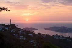 Pink sunset in #Acapulco, #Mexico | Top Reasons To Go: The daredevil cliff divers of La Quebradar // Gorgeous beaches on every turn // a healthy dose of history & arts // Sport fishing: Sail and dorado are Acapulco's premier big-game fish, but marlin and tuna also test anglers' skills.