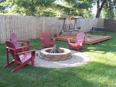 Backyard Idea. Pallet deck with stone fire pit.
