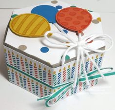 Make a Hexagonal Decorated Birthday Gift Box with the Window Box Thinlits Dies and then decorate for a birthday or any occasion.  https://www.stampinup.com/ecweb/ProductDetails.aspx?productID=142762&dbwsdemoid=54345