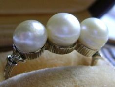 Antique Triple Natural Saltwater Pearl Ring: Type of pearl:  Natural saltwater  Carat Weight:  3.3 grams (weight of ring with pearls)  Shape:  Off-round  Size of pearls:  6.55mm to 6.84mm  Color: