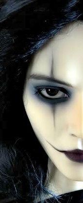 pale face, dark grey makeup with black eyeliner!