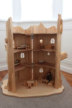 I want this. I might let the kids play with it. ~chris  Tree Stump Fairy House