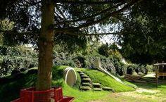 Klimheuvel onder de bomen - schoolpleinontwerp Natuurlijk spelen - Driebergen
