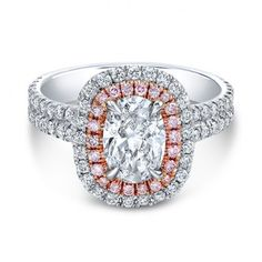 WOW! This engagement ring is amazing! I love the halo with pink diamond accents and oval center stone.