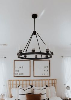 boho modern beiges and whites with bamboo headboard and gallery wall master bedroom. Beautiful farmhouse chandelier
