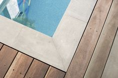 """Nulla Bluestone pavers feature subtle blue/grey tones and exude envious character through small """"cat paws"""" also known as vesicle, presented throughout the stone. Pool Paving, Outdoor Paving, Bluestone Pavers, Pool Builders, Small Cat, Cat Paws, Cool Pools, Stepping Stones, Landscape Design"""