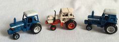 2 Blue Ford Tractors & 1 Case Tractor Metal Diecast 1/64 Scale #ERTL #Ford