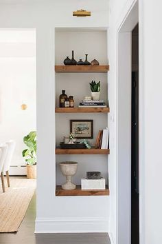 reDesign Home LLC. chunky timber shelves in a wall niche reDesign Home LLC. chunky timber shelves in a wall niche Niche Living, Living Room Shelves, Living Room Storage, Living Room Decor, Alcove Ideas Living Room, Timber Shelves, Recessed Shelves, Built In Wall Shelves, Shelving