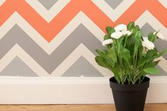 In keeping with the chevron pattern, this wallpaper will look so cute in my closet/office