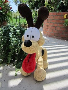 Just another angle of Odie Many, many hours, a couple re-do's, 4 blisters, and a bent yarn needle later.. Odie is born! I accidentally made him too big (again with the scaling problems), but I was ...