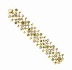 A DIAMOND, PERIDOT AND GOLD BRACELET, BY JEAN SCHLUMBERGER, TIFFANY & CO. The 18k gold sculpted band of latticework design, set with circular-cut peridots and circular-cut diamonds, mounted in 18k gold.