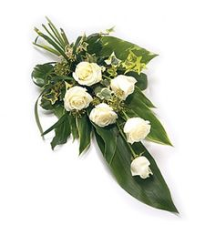 Sometimes it is so difficult to find the right words of sympathy but this sheaf of beautiful white roses with pretty green foliage will express your feelings at this most sensitive time.
