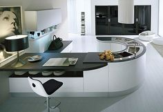 Minimalist kitchen design is all about slim and sleek in. A minimalist kitchen design is that kitchen than compiles extreme modern kitchen accessories with straight shaped lines and all the accessories from such a kitchen will take minimal space. Curved Kitchen Island, Round Kitchen, Kitchen Islands, Contemporary Kitchen Design, Interior Design Kitchen, Kitchen Designs, Kitchen Ideas, Kitchen Trends, Interior Ideas
