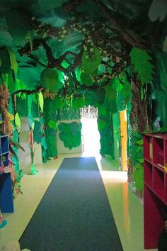 With the help of dim lights, papier-mâché sculptures, drawings, a vaporizer and an iPad, the hallway at Upper saddle River Children's Academy is transformed into a rainforest.