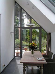uitbreiding leefruimte - zicht op tuin en vijver - architect a.wildro