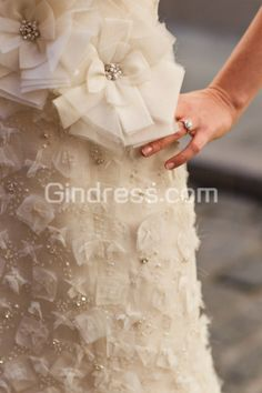 Not the typical white dress, elegant design and incorporation of flowers, vintage style dress