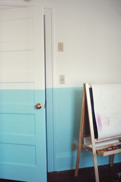 A bright + bold paint job makes this room pop! Love how the half-colored wall extends onto the door. Half Painted Walls, Half Walls, Hand Painted, Demis Murs, Two Tone Walls, Interior Paint Colors, Interior Painting, Apartment Painting, Painting Doors